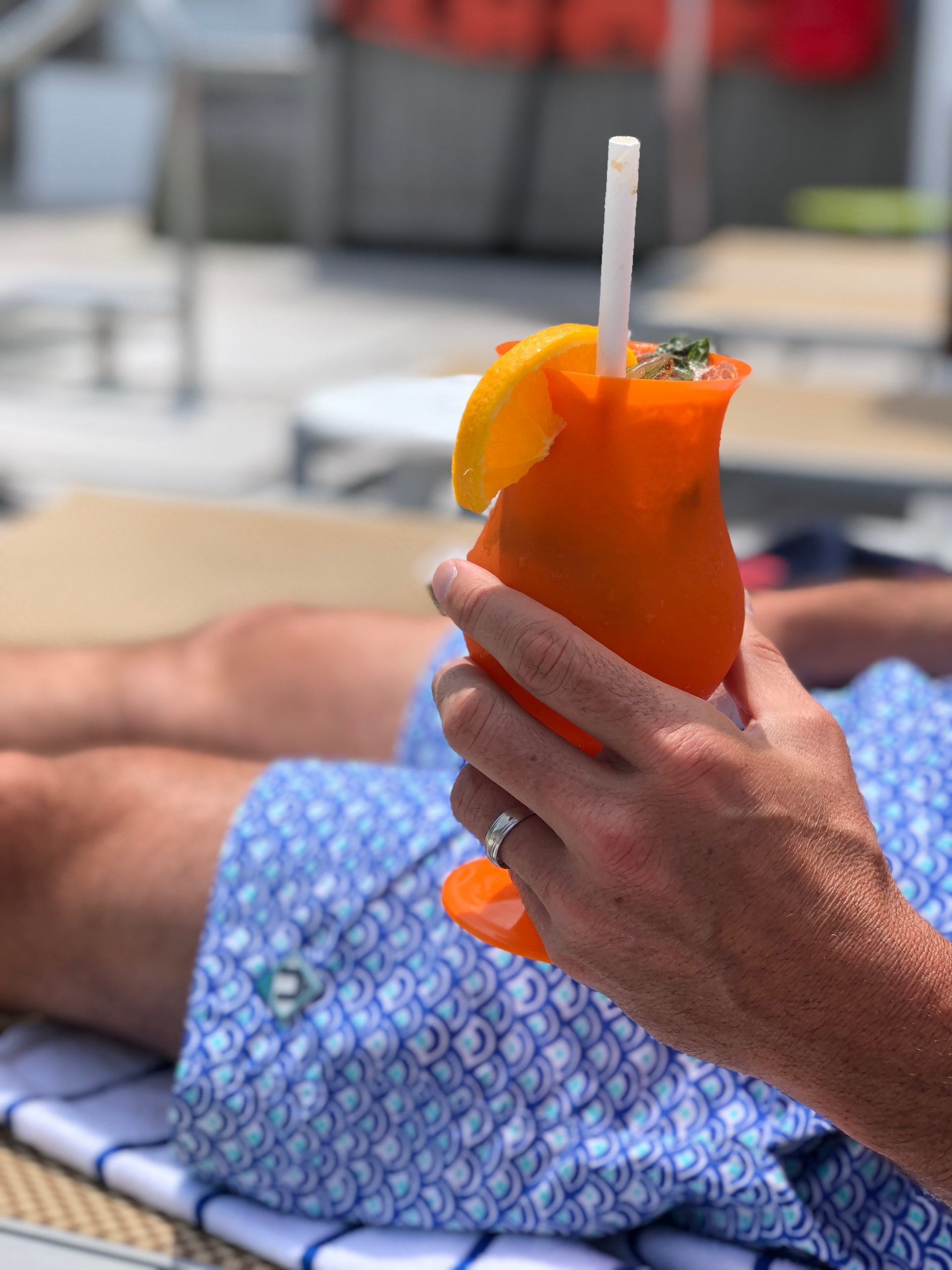 man holding mojito cocktail at The Nantucket Hotel poolside