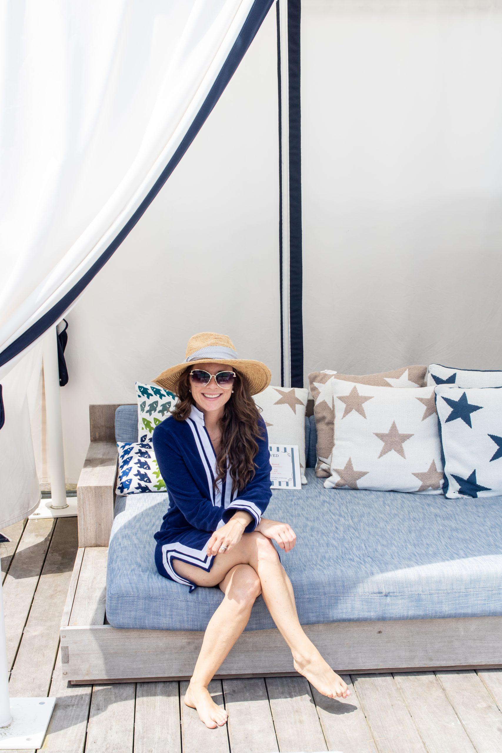 Woman wearing sun safe Cabana life shirt and swim shorts at the Nantucket Hotel and Resort