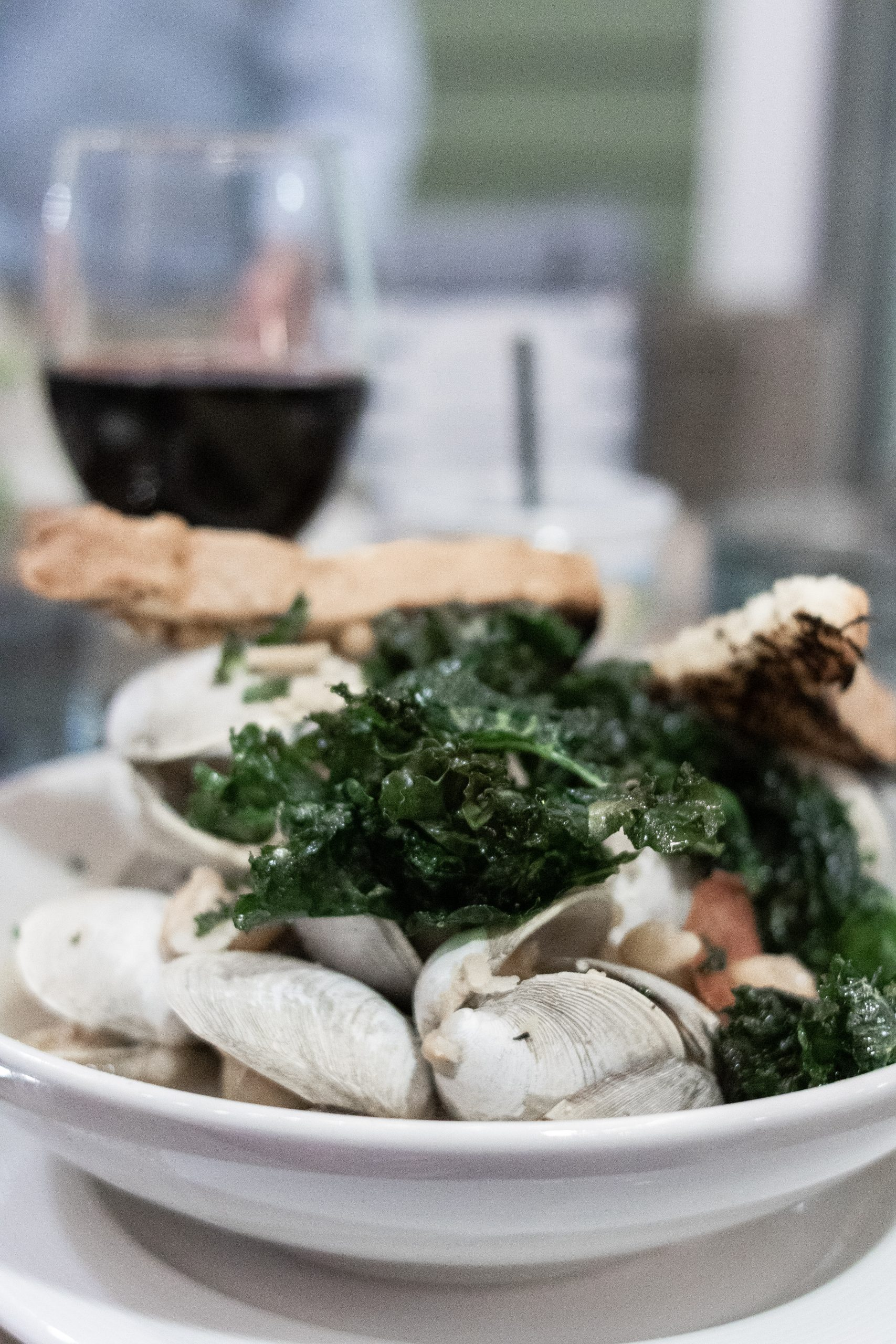 Steamed Clams in broth with cannelloni beans and Kale Chips