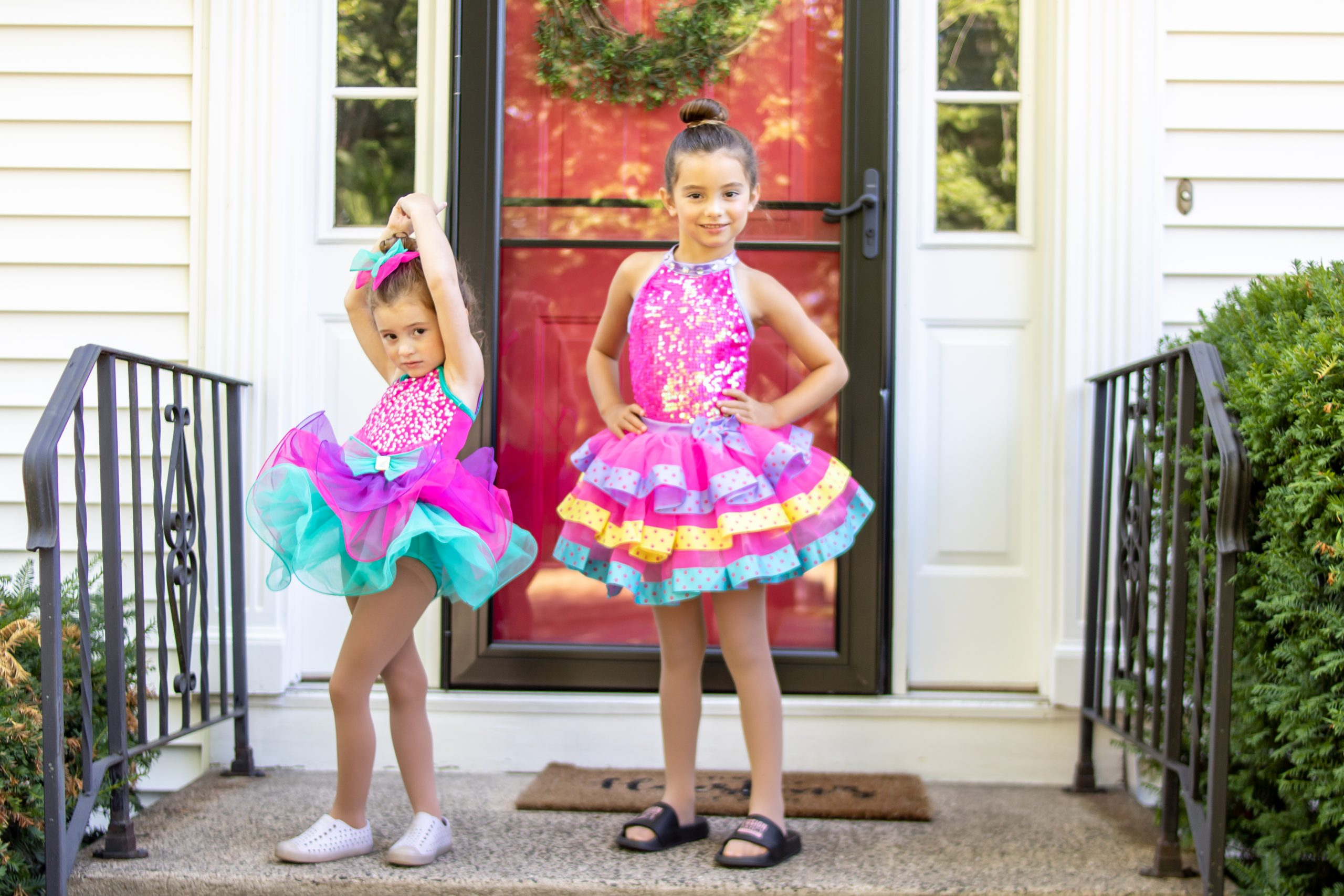 sisters in dance costumes for recital in July