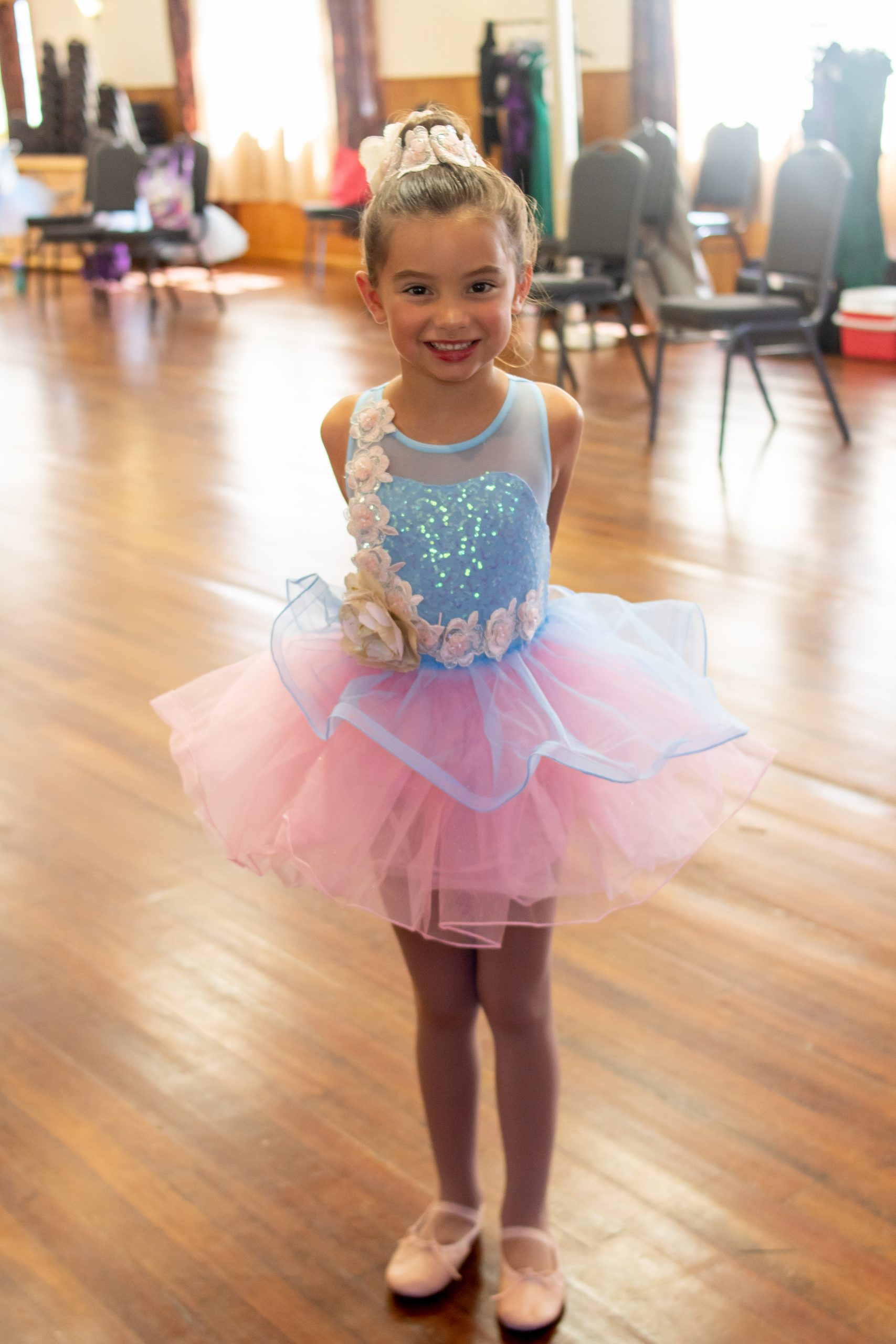 little girl in blue and pink ballet costume