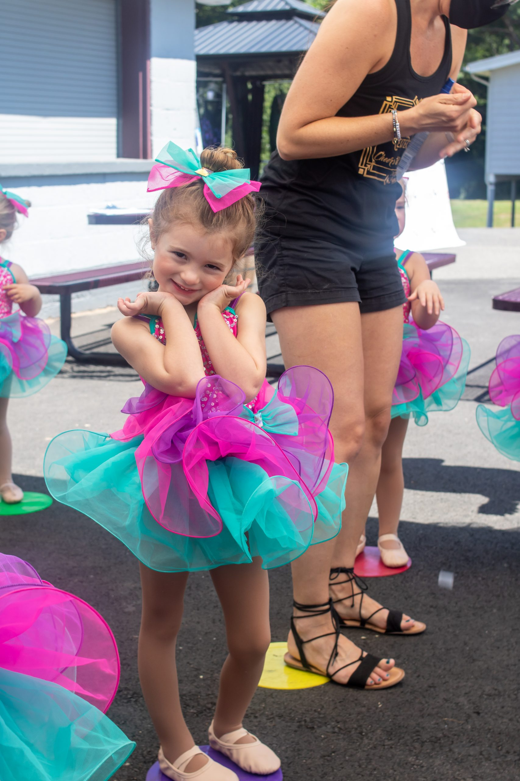little girl in pink and purple ballet costume
