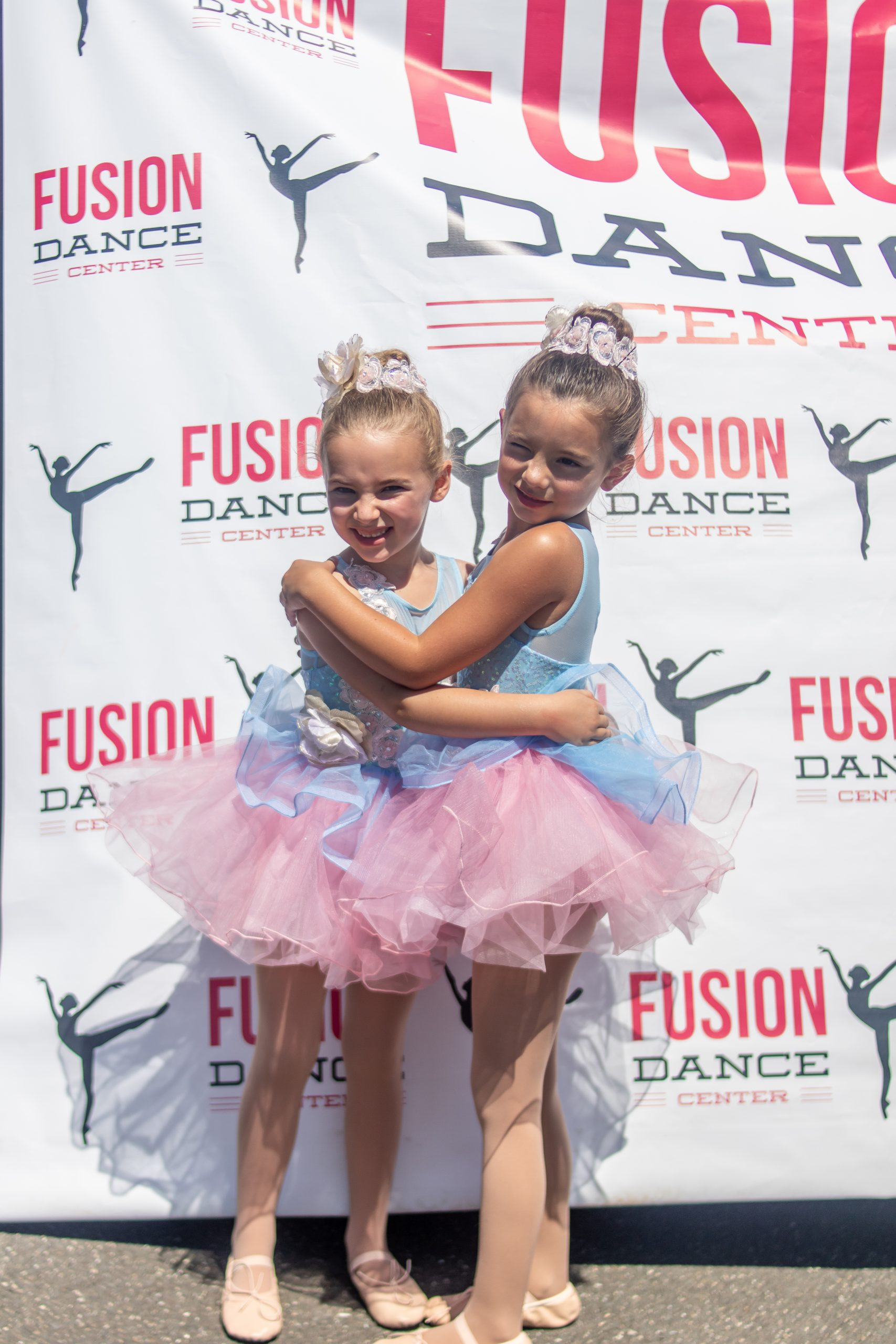 cousins in pink and blue ballet costumes