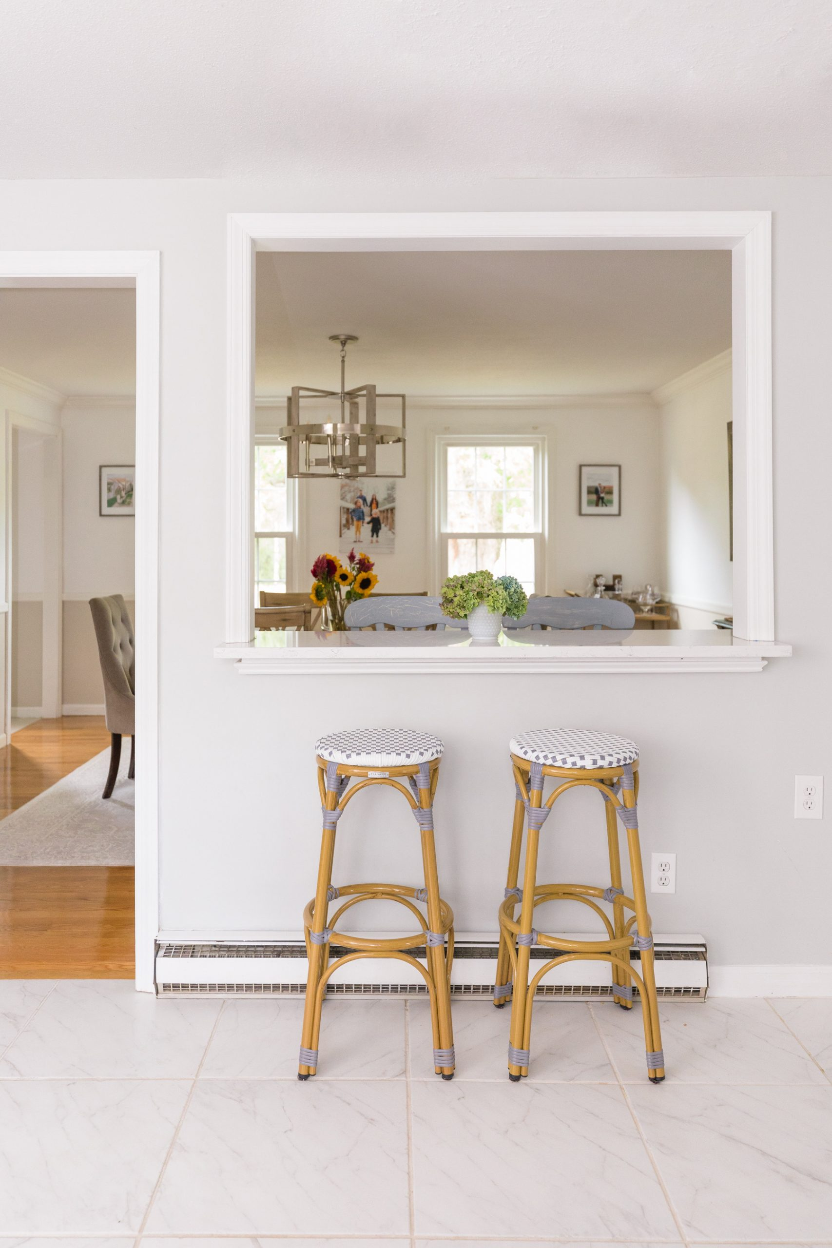 pass through window with breakfast bar in kitchen