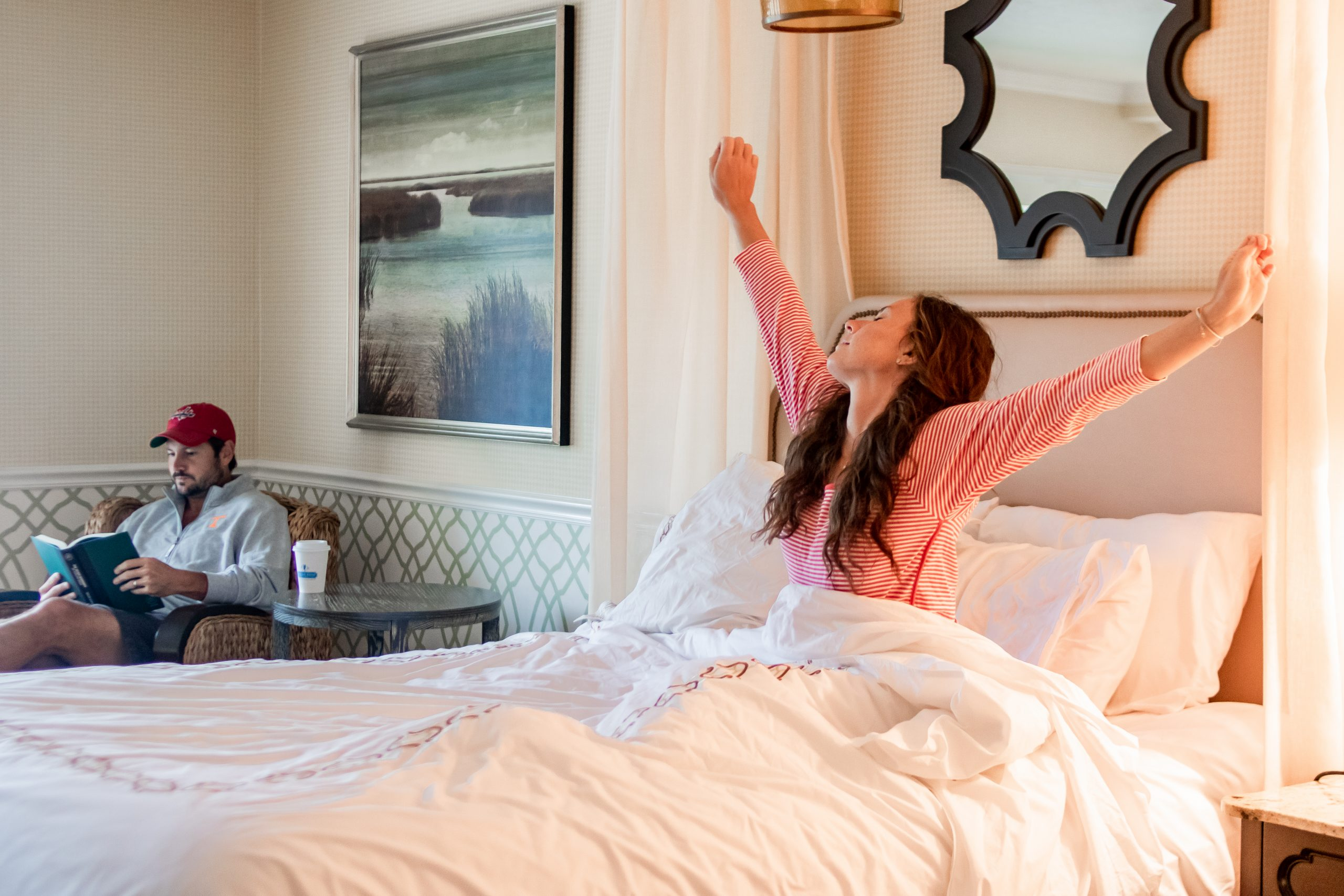 woman waking up in bed at Ocean Edge Resort