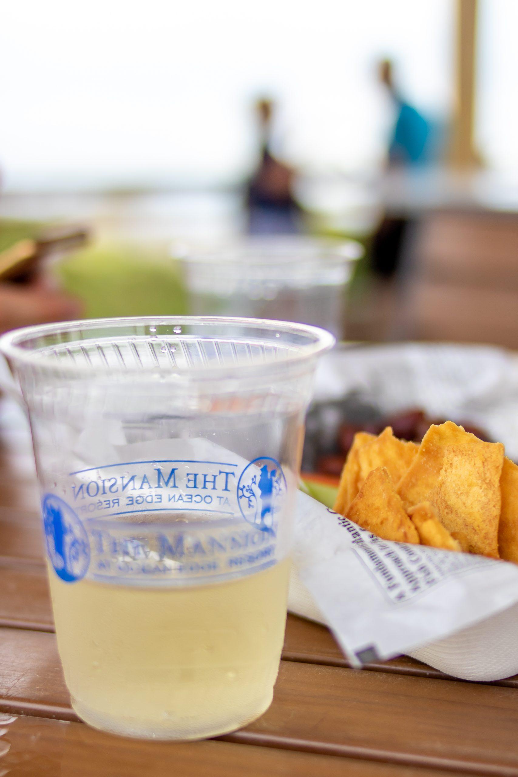 wine and hummus plate at beach bar