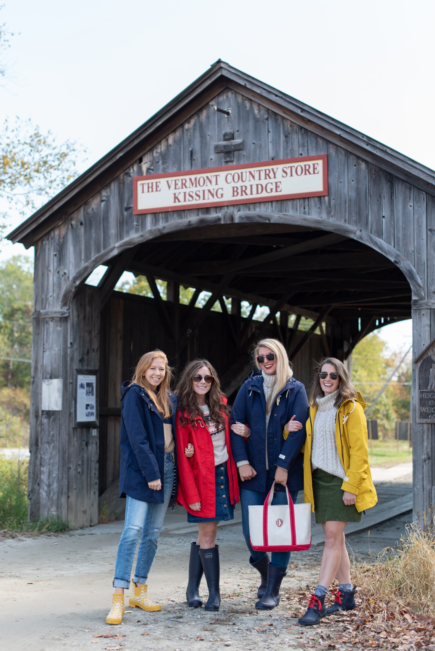 Girls standing in front of Vermont Country Store Kissing Bridge wearing Joules