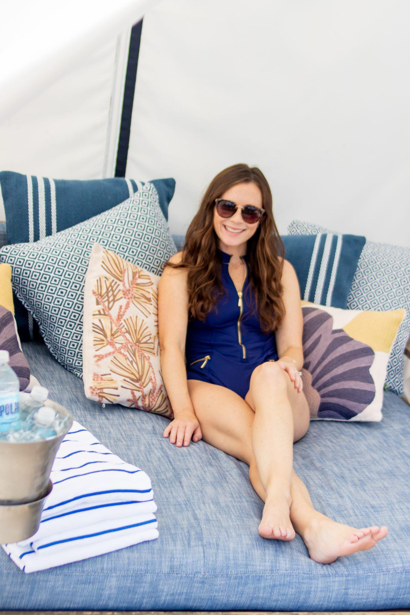 Woman in zip up cabana life bathing suit in cabana poolside winnetu