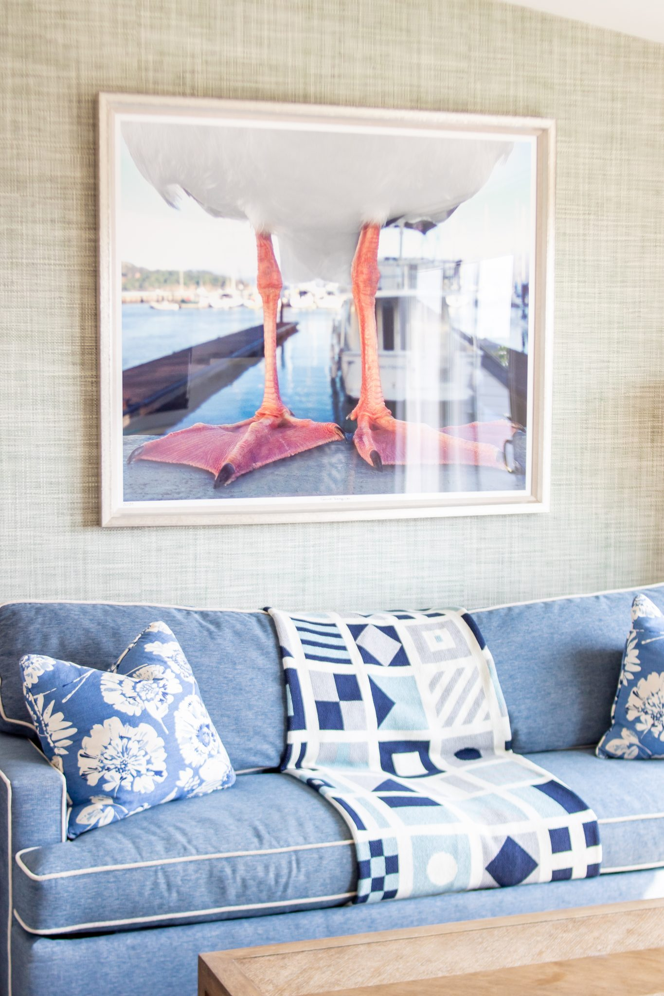 Winnetu - West Chop One Bedroom Suite - Seagull Feet Photograph above navy couch with Grasscloth wallpaper