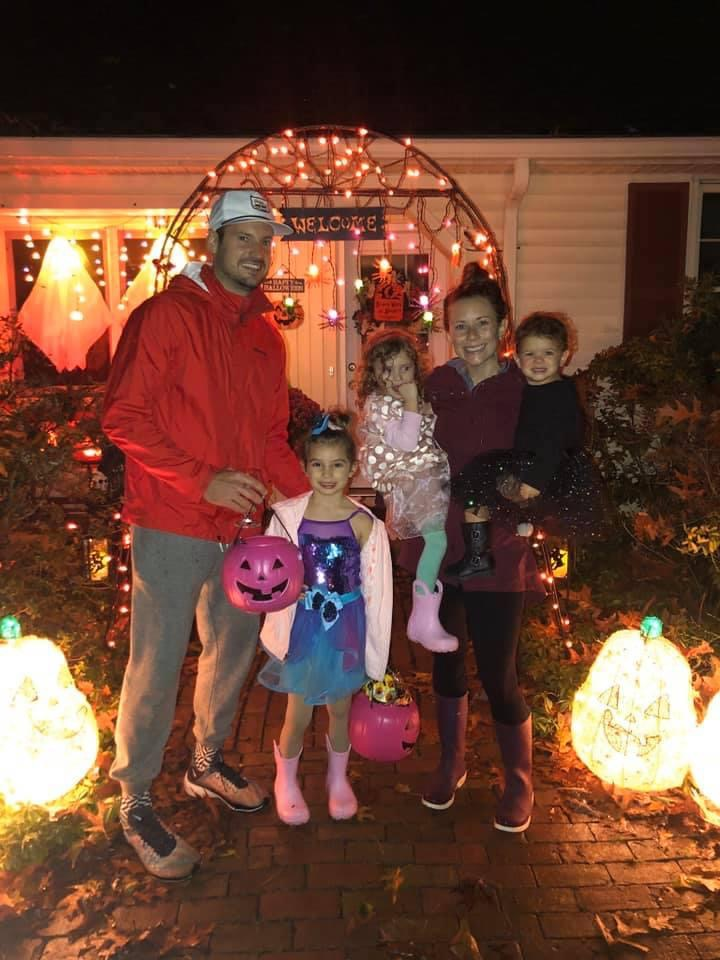 Family on Halloween in costumes