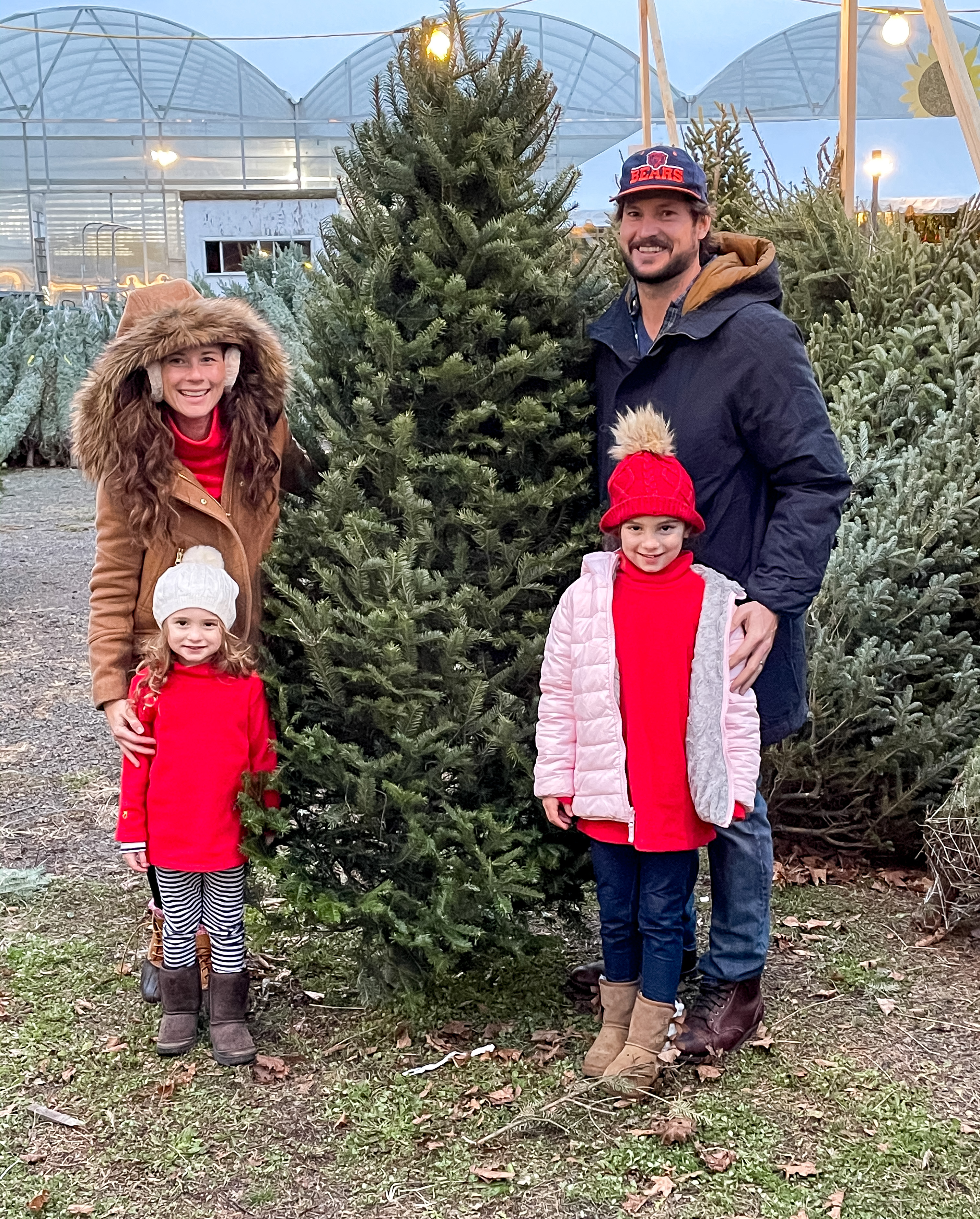 Family with cut down Christmas Tree at Beaumonts Farm Connecticut