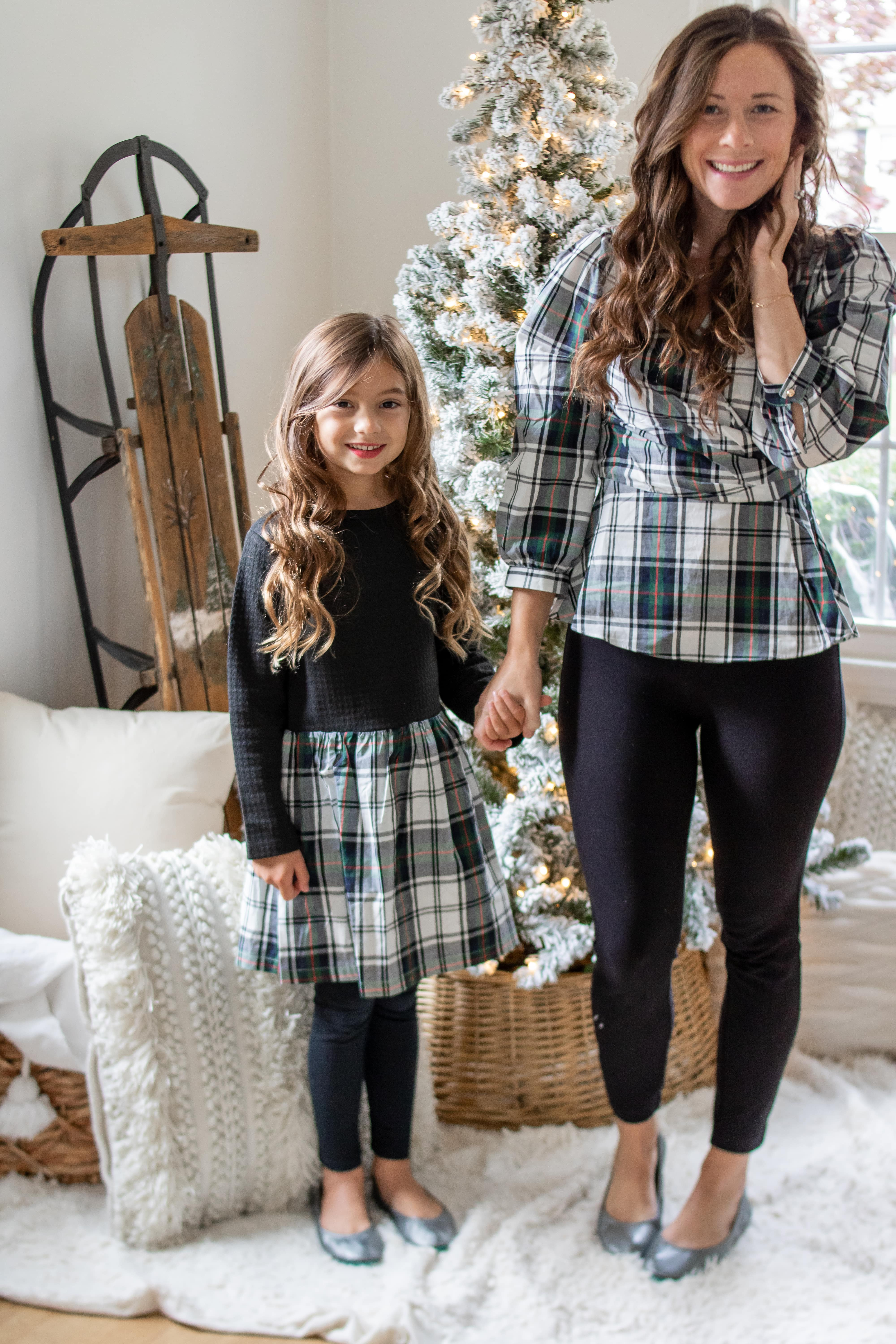 little girl with at mom wearing matching black plaid outfits and Tieks