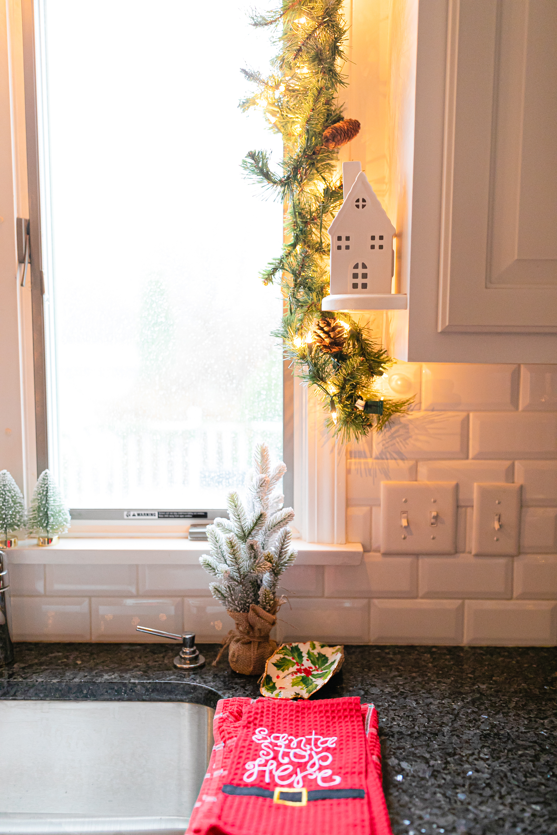 real garland above kitchen sink with lights