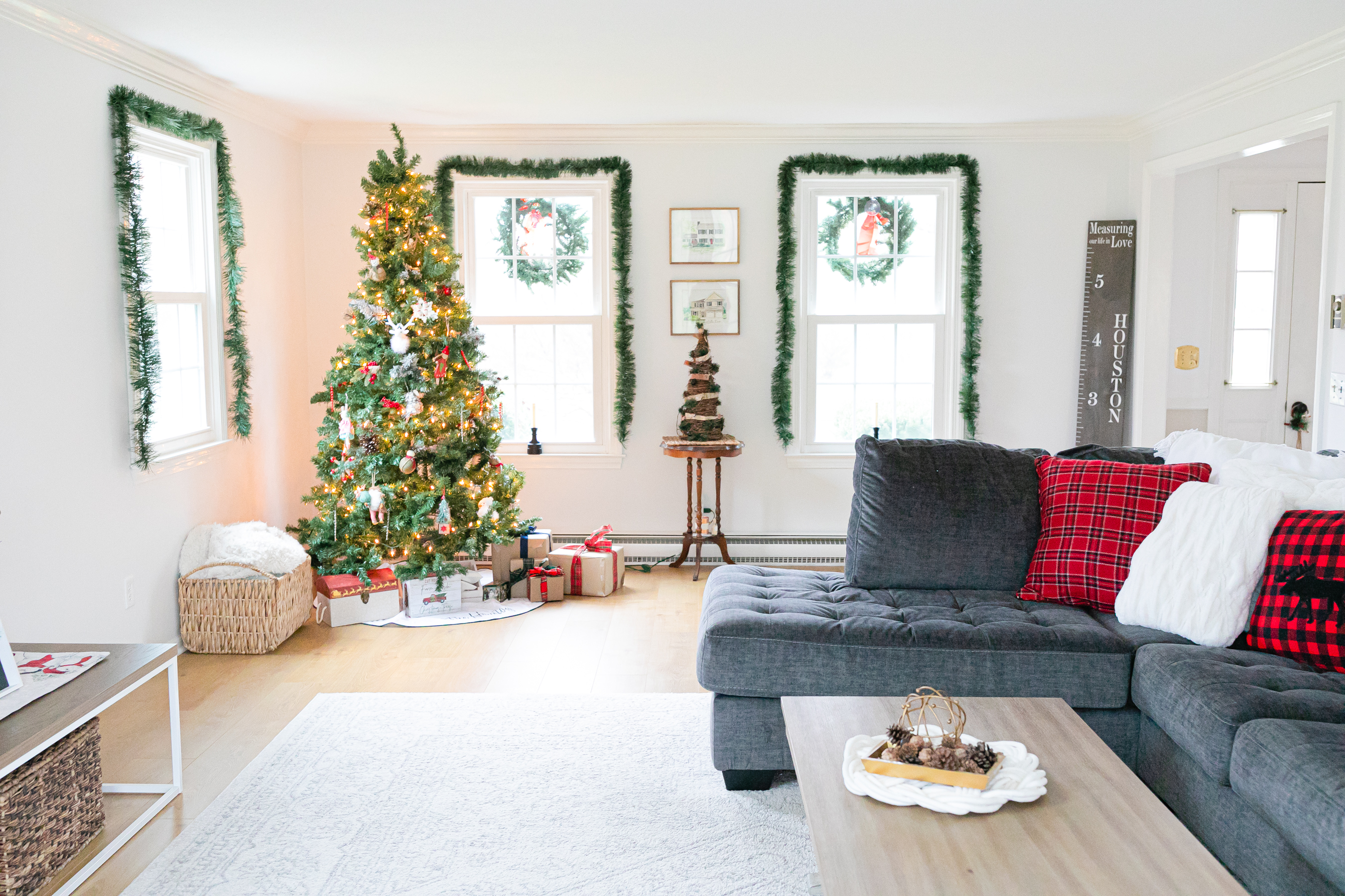 white living room gray couch decorated for christmas