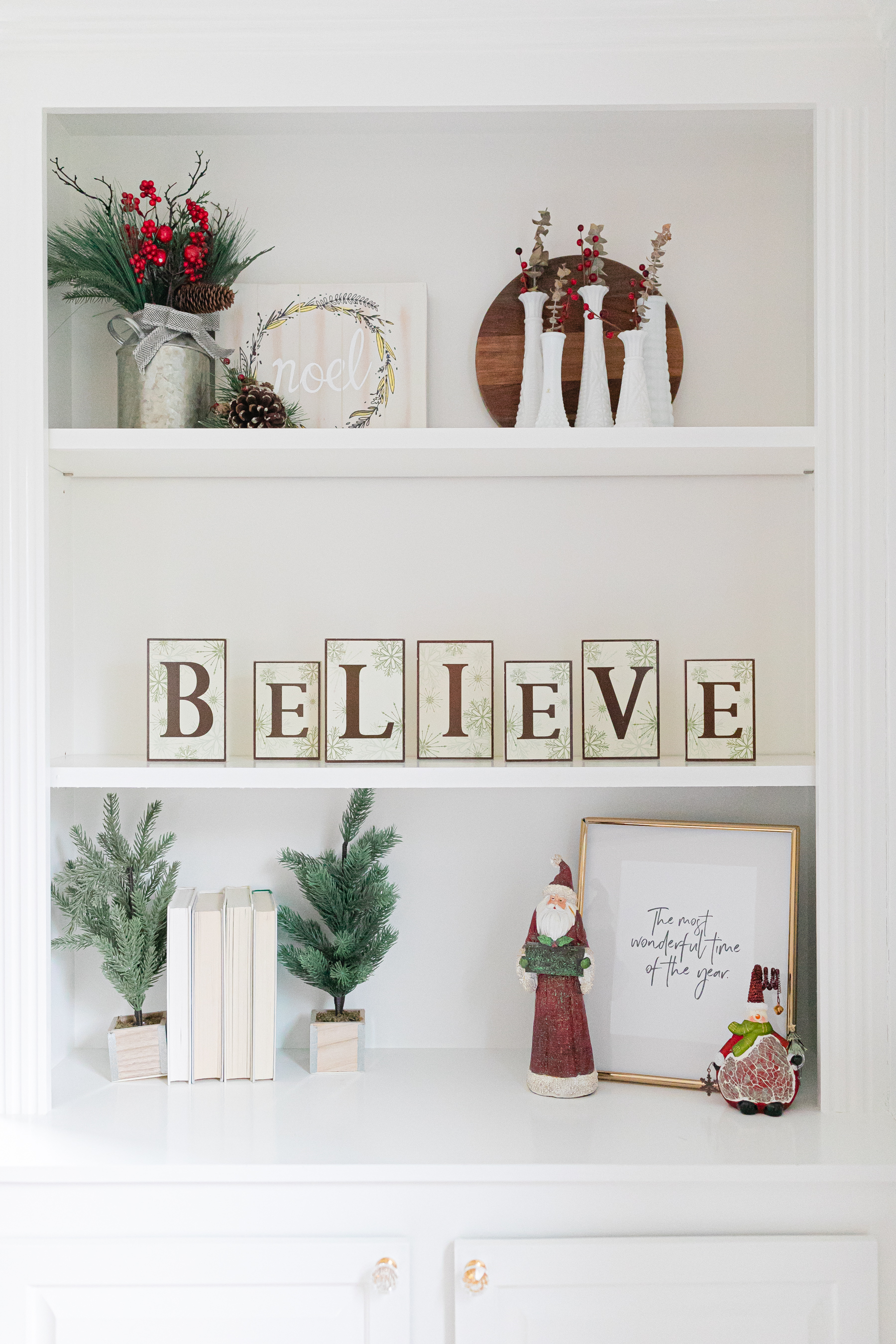 white built in shelving decorated for Christmas
