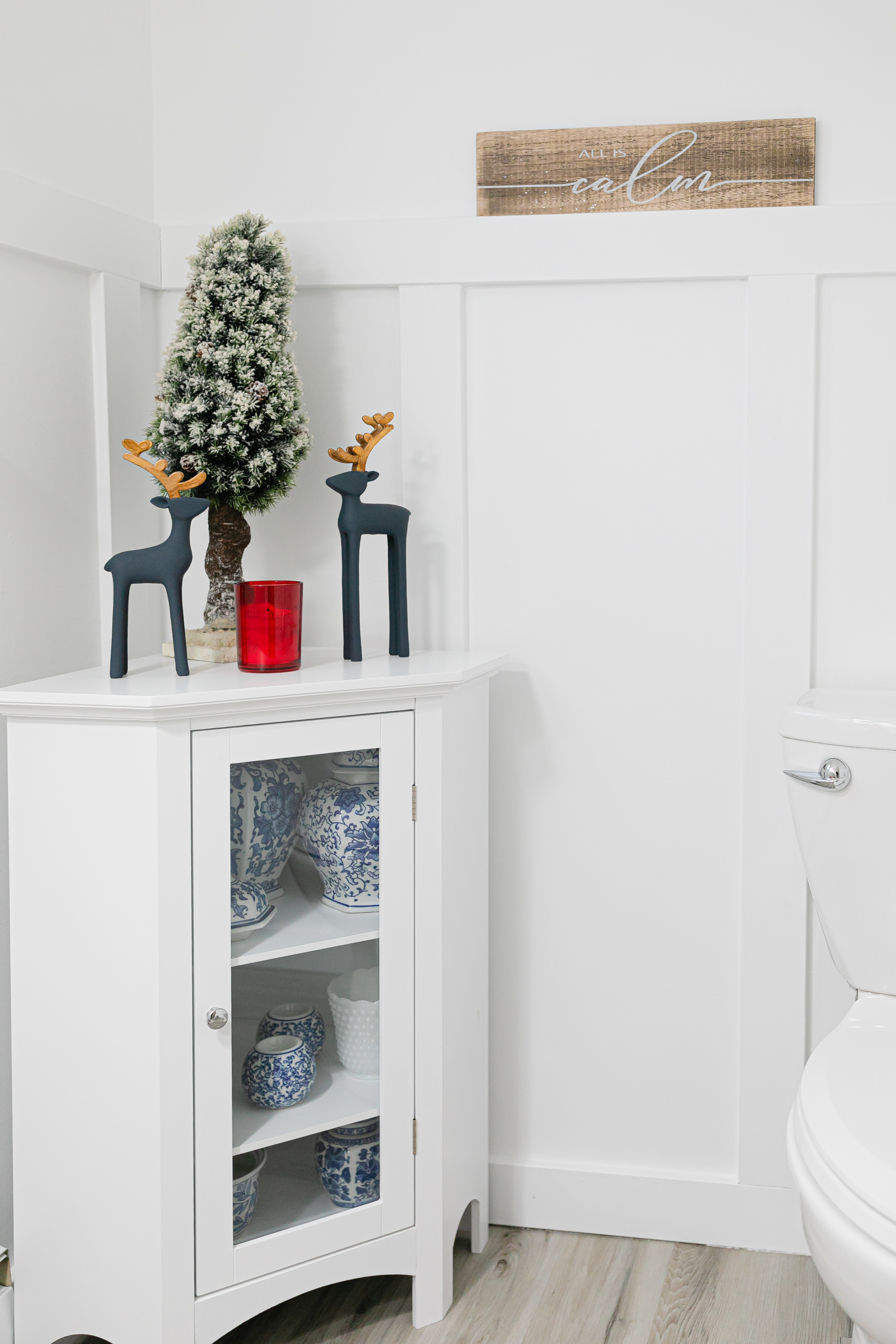 bathroom corner cabinet decorated for christmas