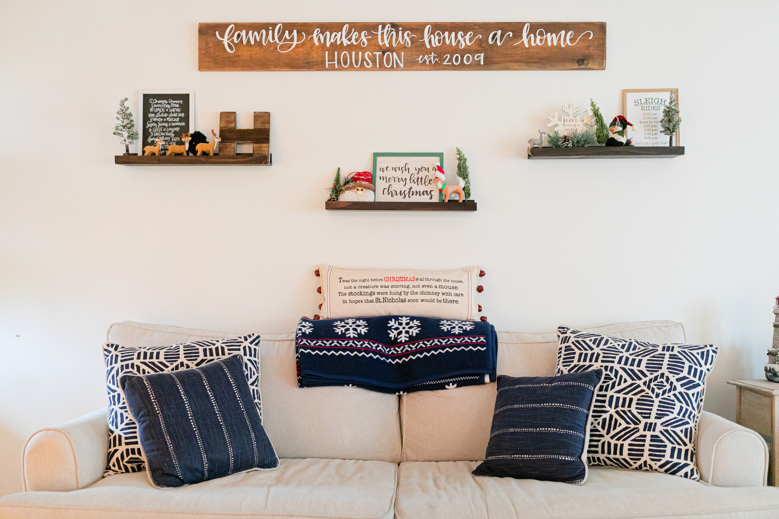 holiday decor on floating shelves above couch