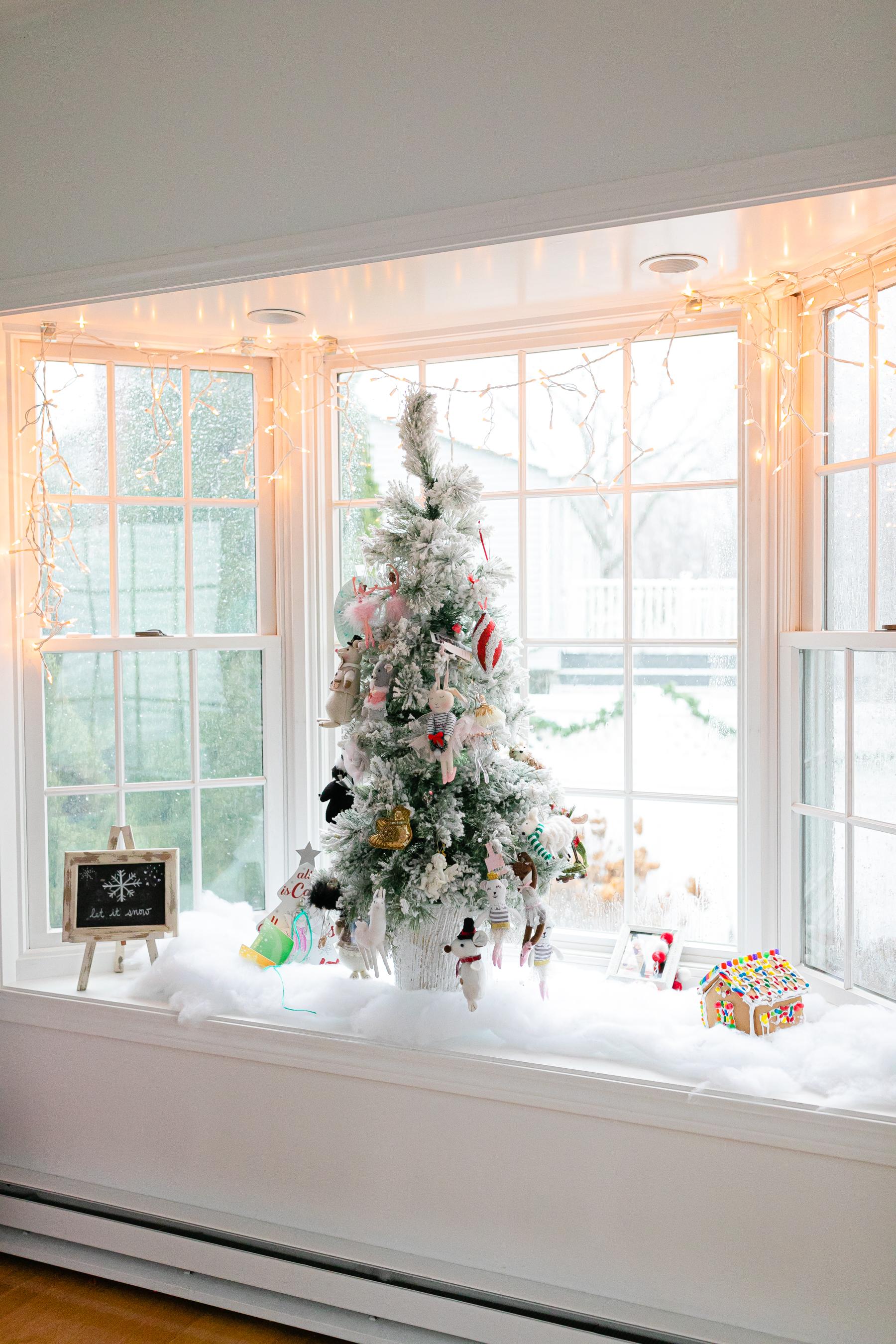 flocked christmas tree in window seat