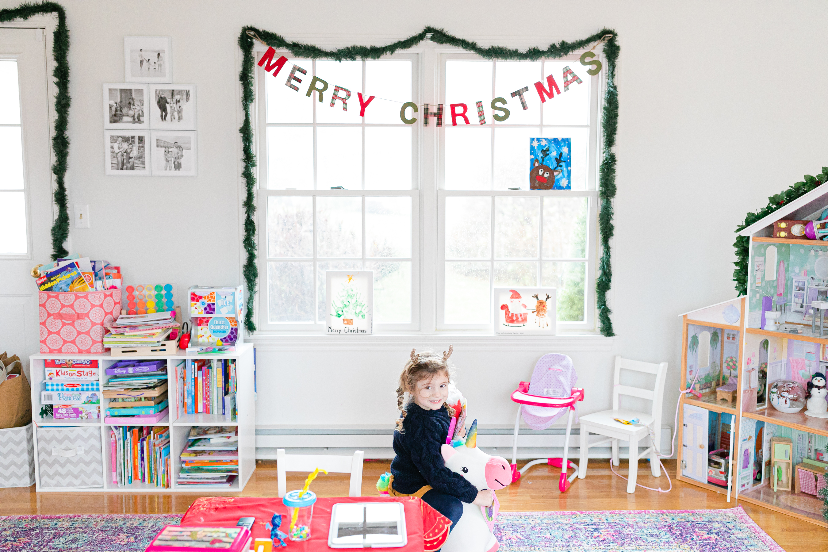 little girl in playroom decorated for Christmas