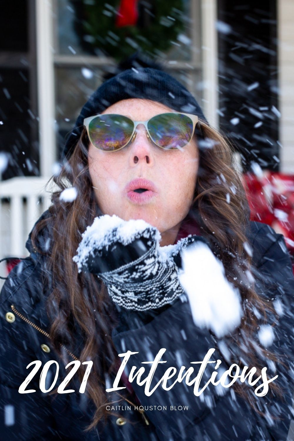 woman blowing snow at camera setting 2021 intentions