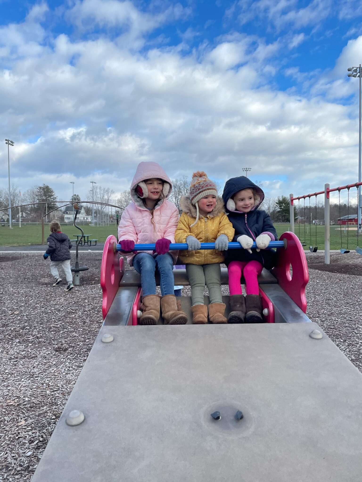 little girls on seesaw at park