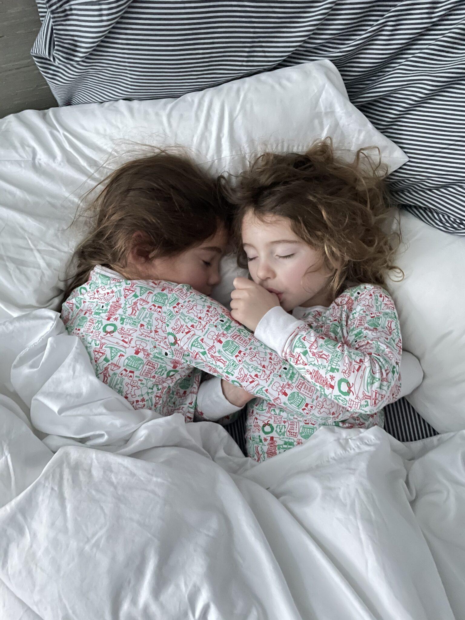 Sisters snuggling asleep