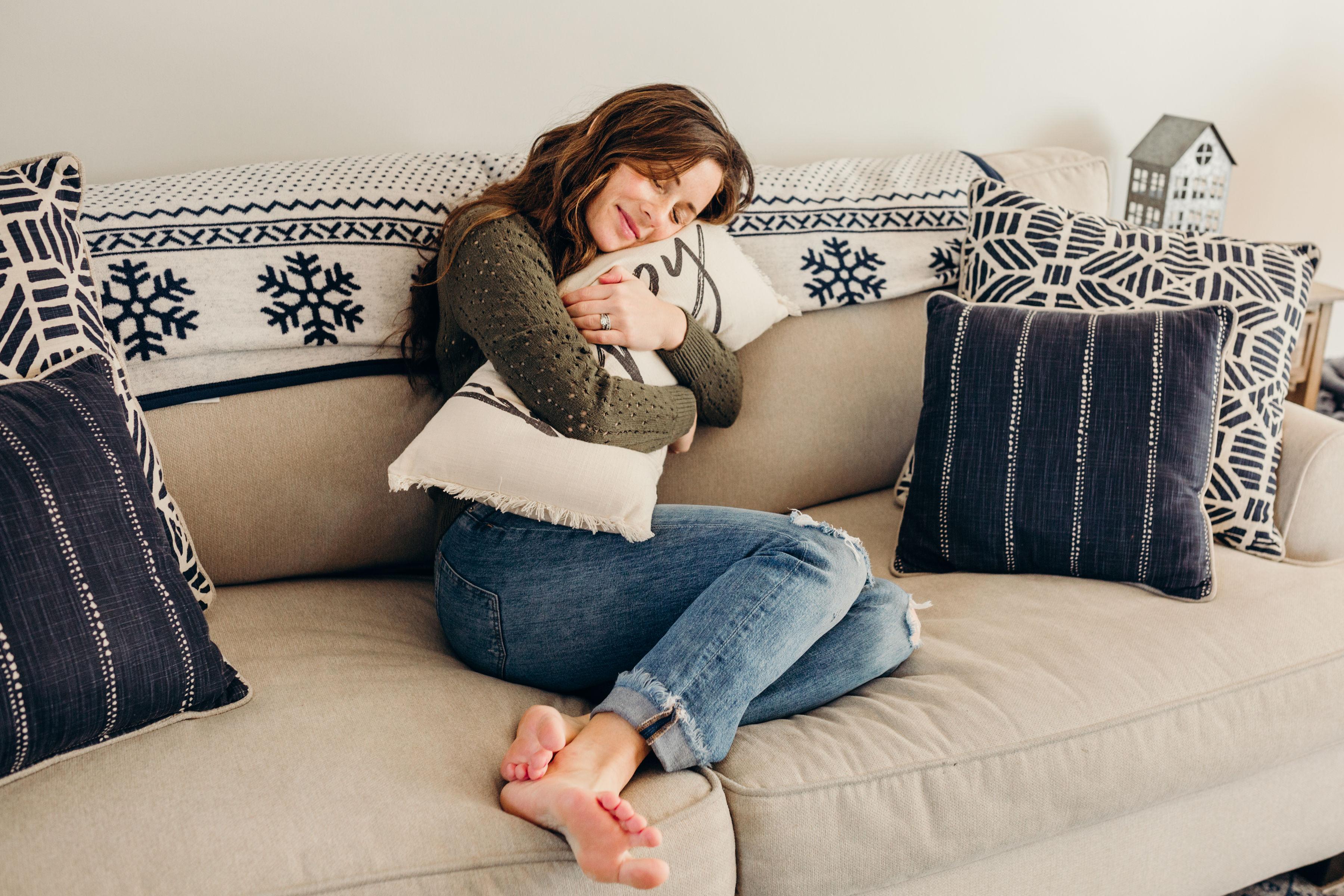 woman hugging happy pillow friday favorites