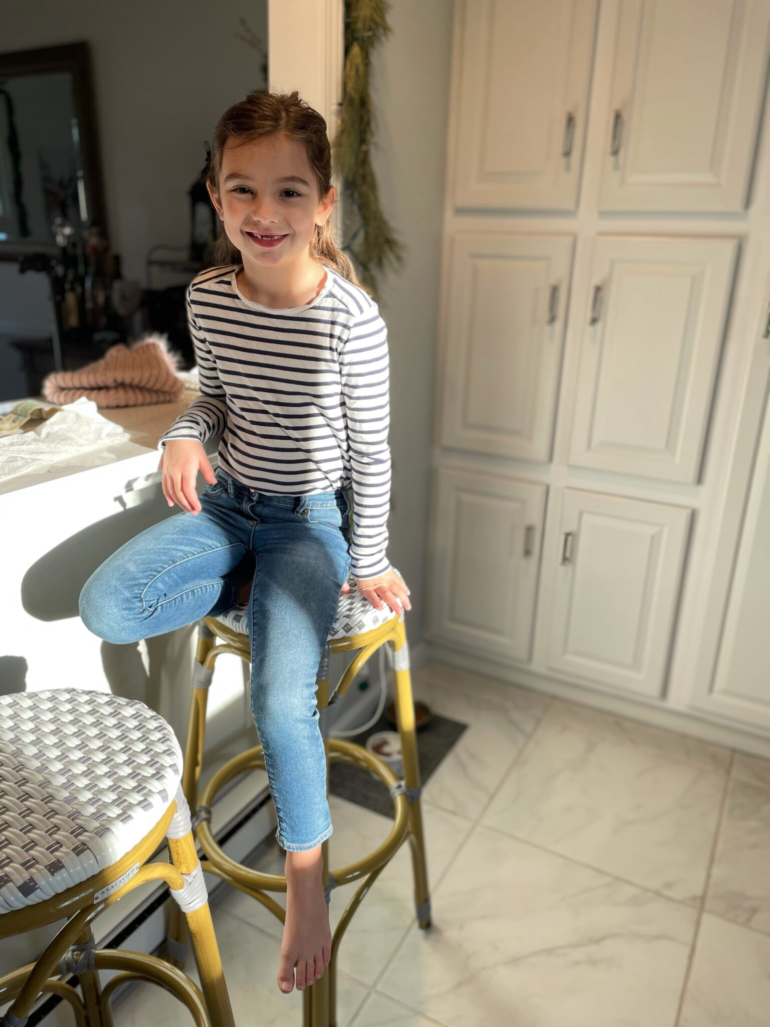 little girl in striped shirt and jeans