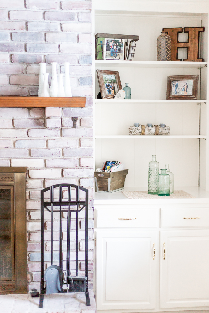 Whitewash Fireplace and White Built in Shelves Living Room