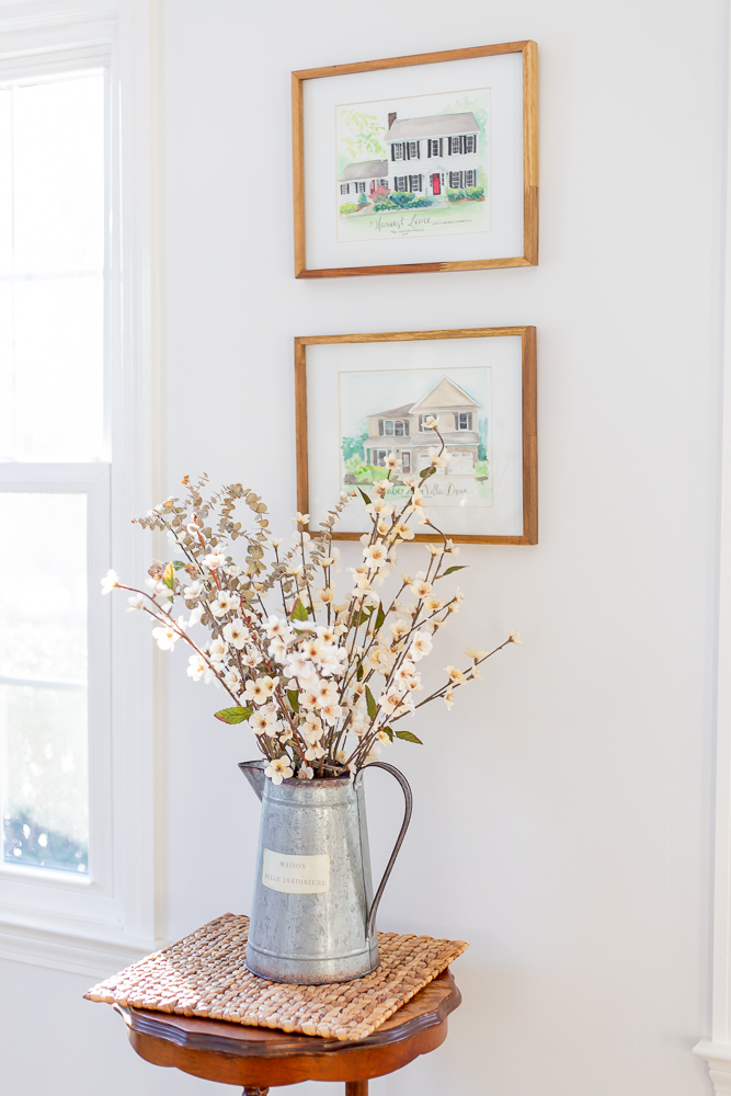 Inexpensive Spring Home Decor on Caitlin Houston Blog - Gold Framed Home Illustrations, Water Can Floral Display