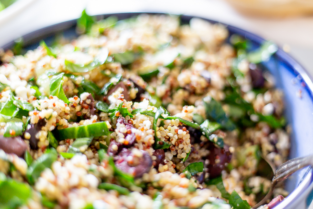 Mediterranean Quinoa Salad in Blue Bowl
