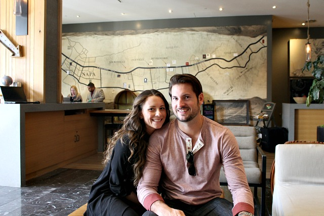 Couple sitting in lobby at Andaz in Napa Valley