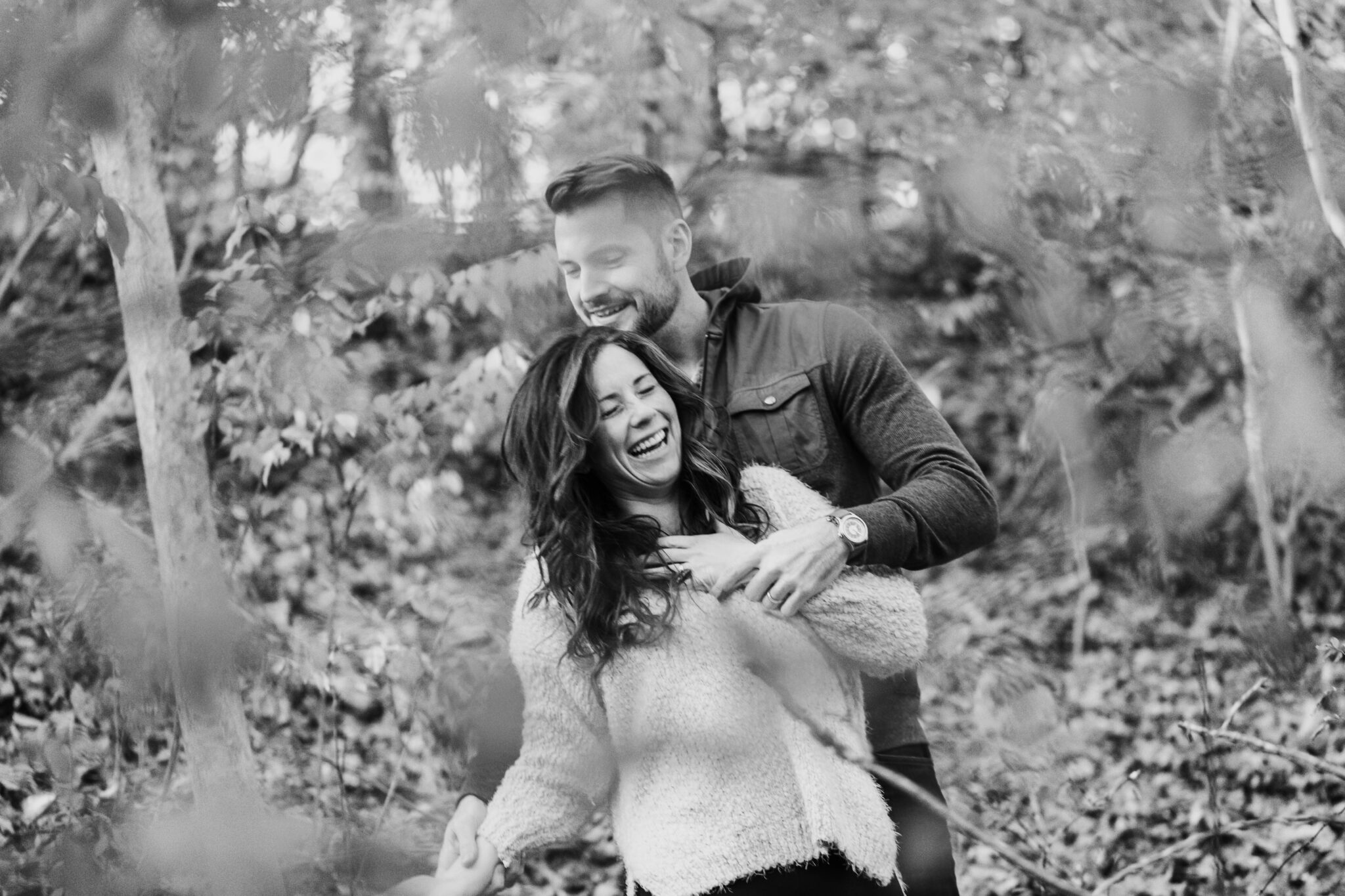laughing couple black and white photo