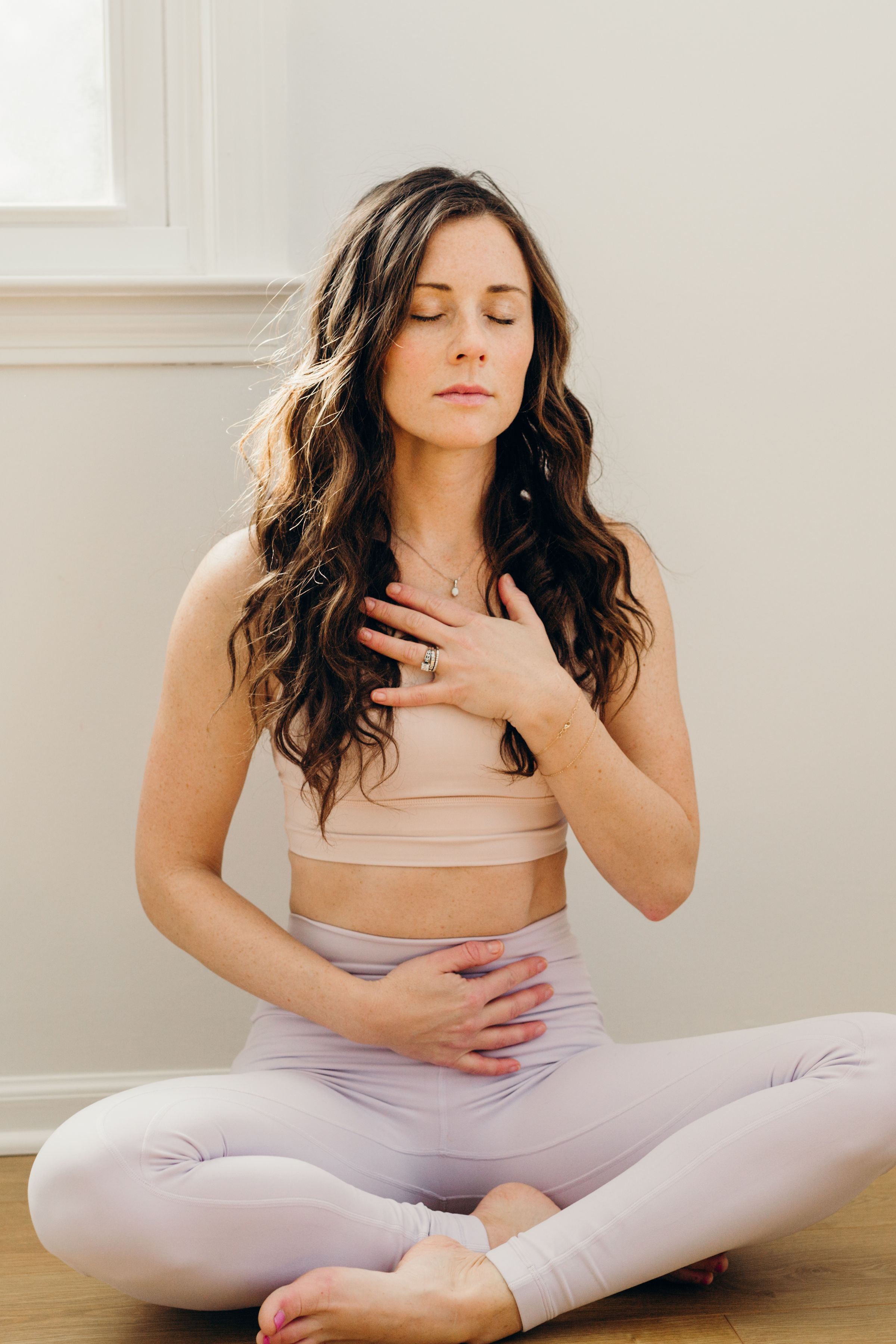 woman practicing meditation during yoga