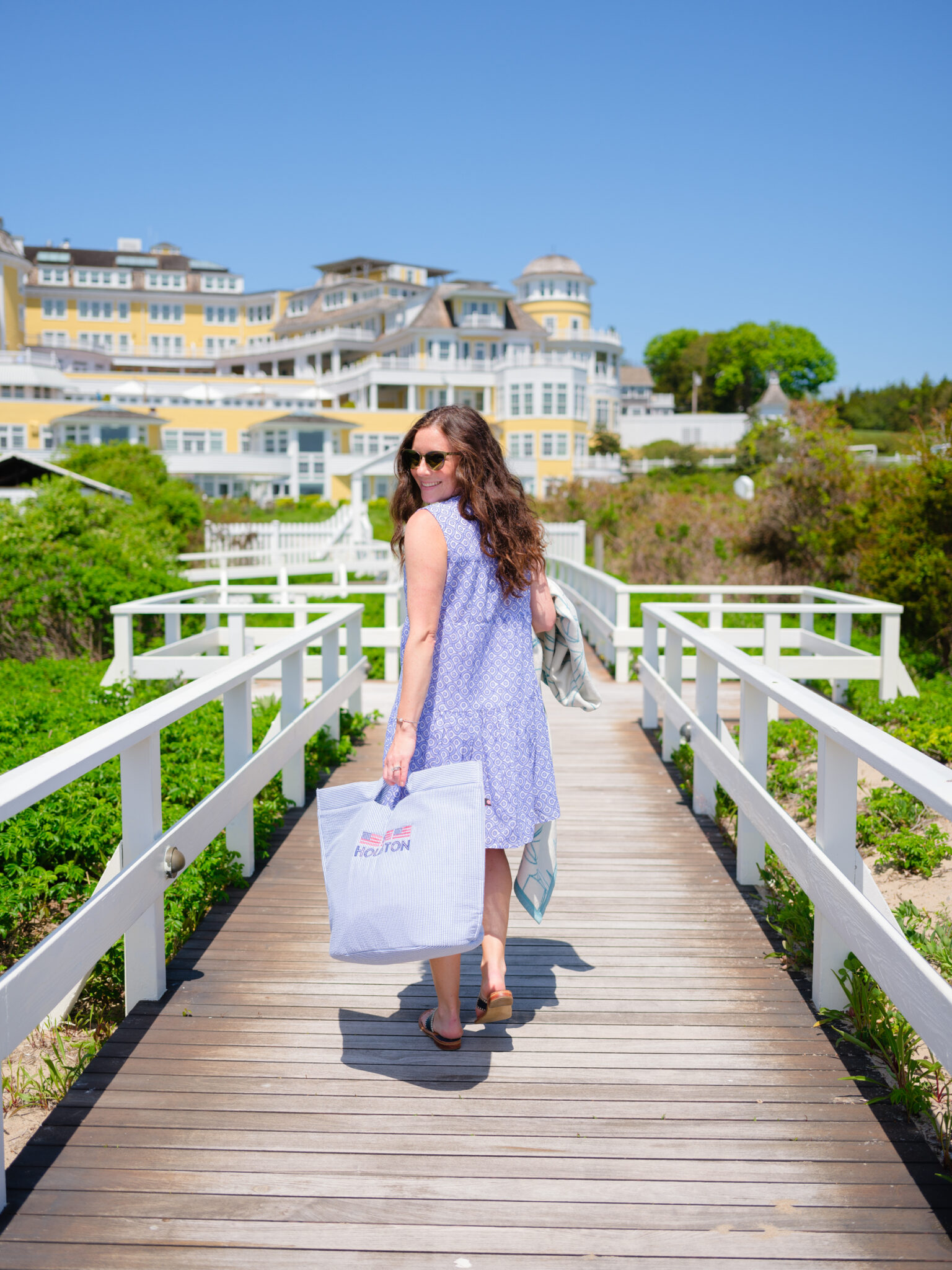 Woman walking with beach bag to Ocean House