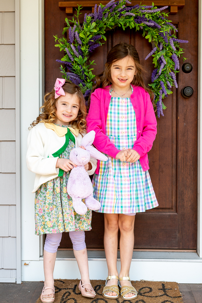 little girls in coordinating outfits with mixing patterns