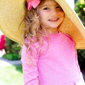little girl in sun safe hat and shirt coolibar