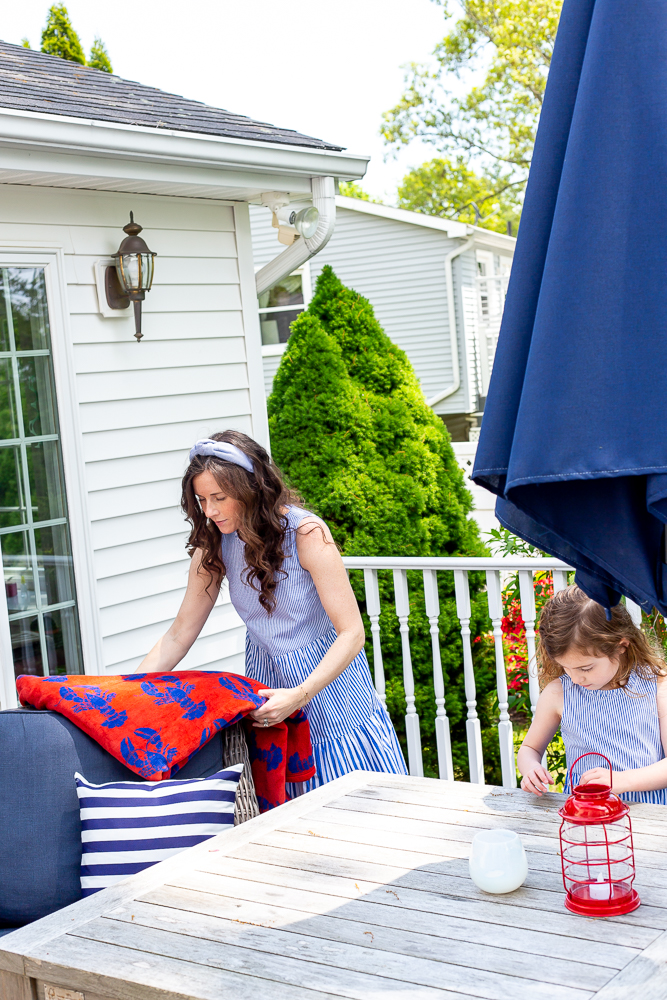 Mom and daughters decorating porch for Memorial Day and summer entertaining