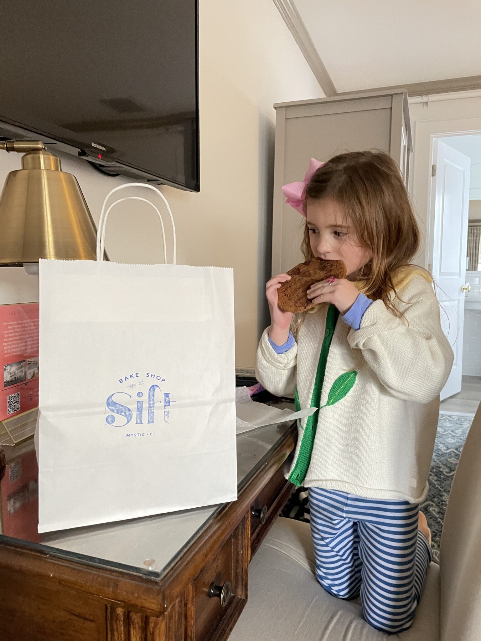 little girl eating cookie from Sift Bakery