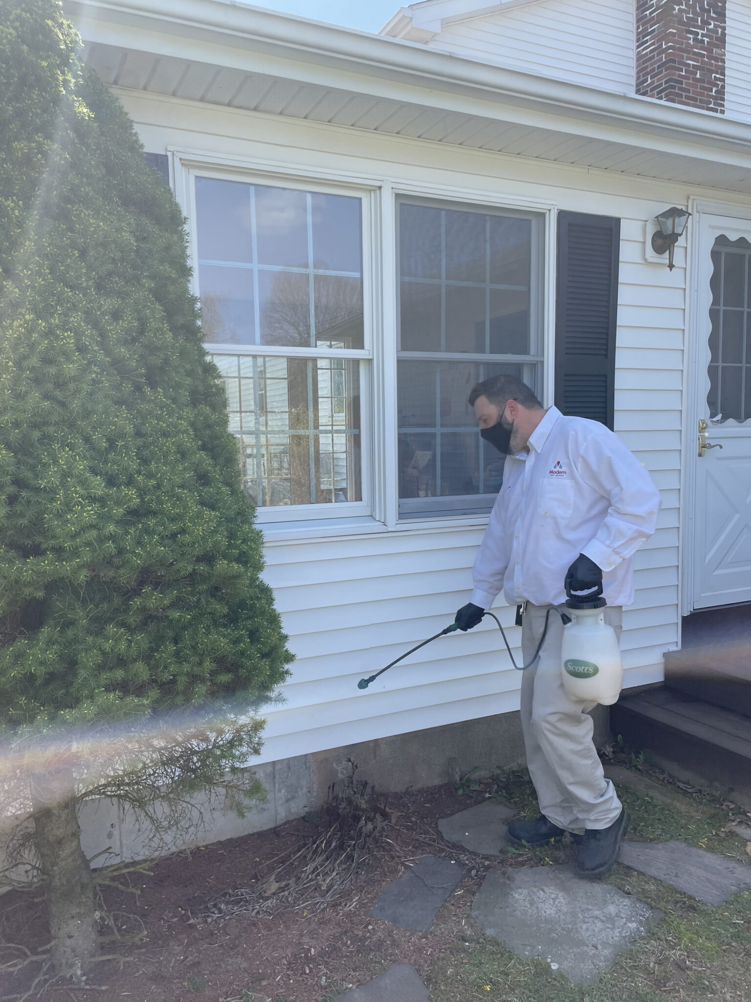 modern pest services treating yard for ticks and mosquitos