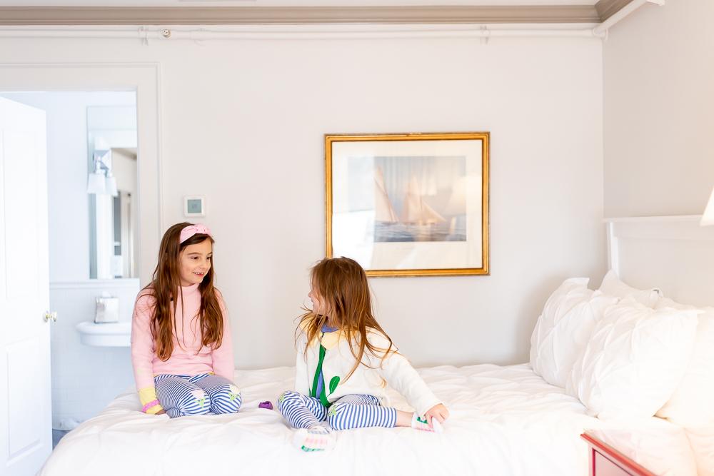 little girls sitting on bed at Whaler's Inn