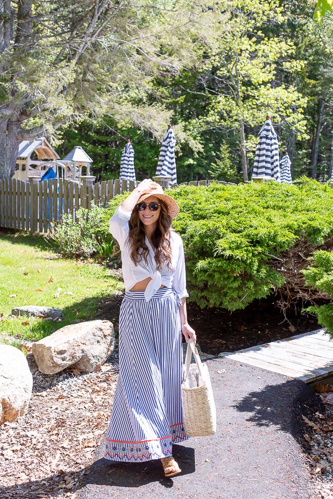 sun protective maxi skirt and grayson button up shirt tied around waist