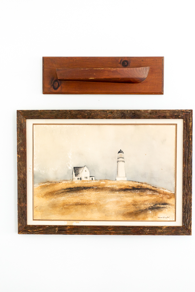 antique boat decor and lighthouse painting Spruce Point Inn