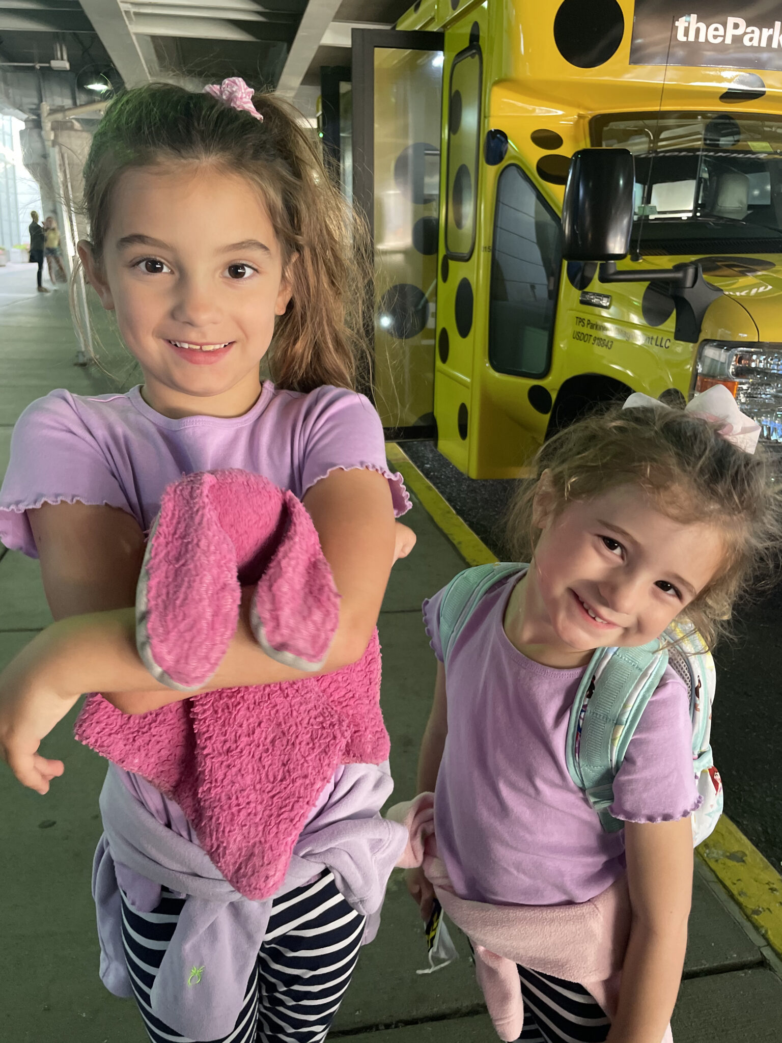 little girls in matching outfits at airport