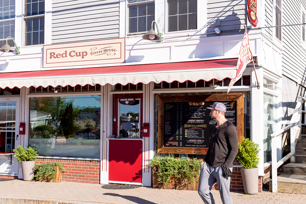 man standing in front of Red Cup Boothbay Harbor