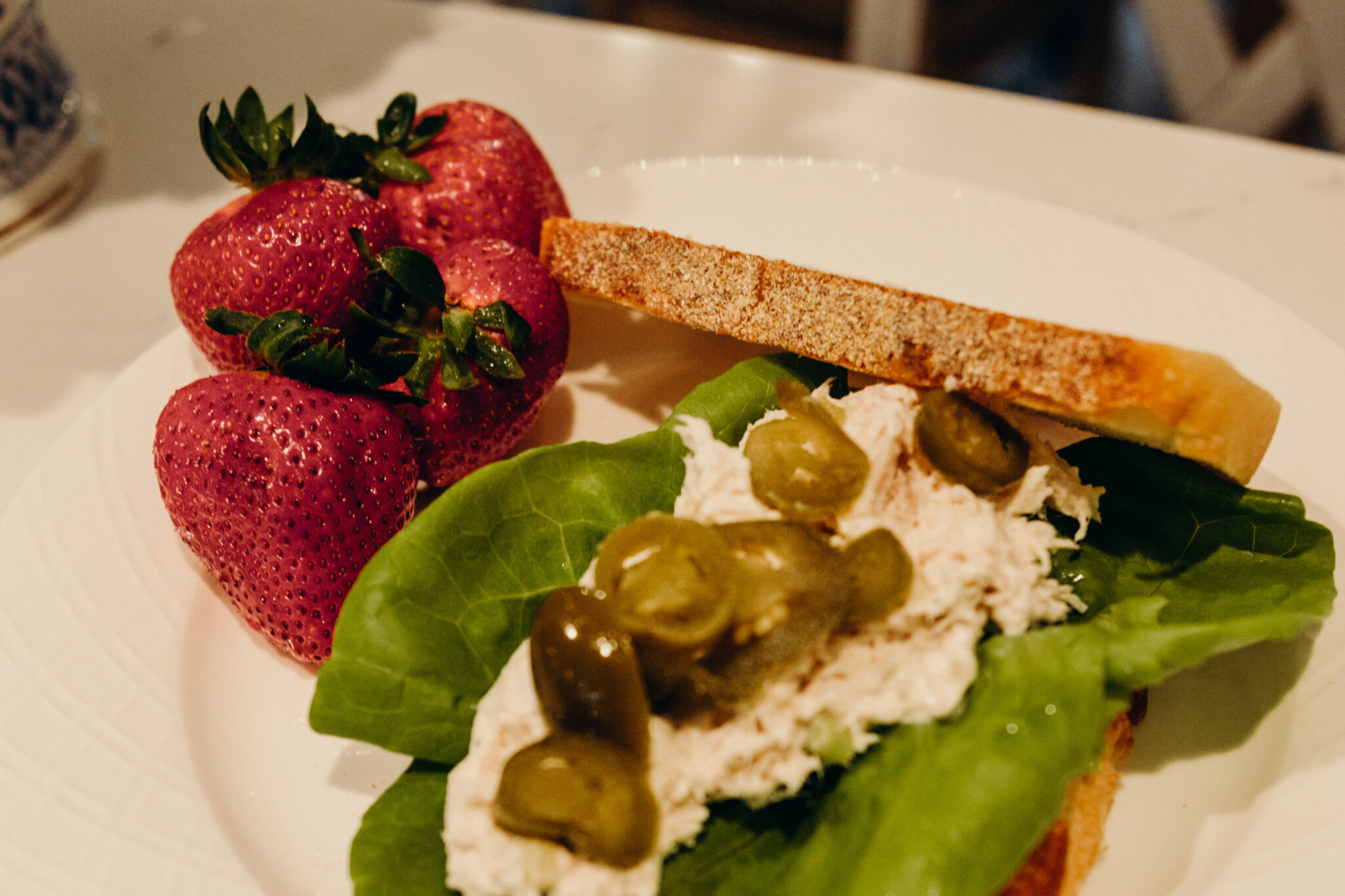 Chicken Salad Sandwich with Jalapenos on Sourdough and Side of Strawberries