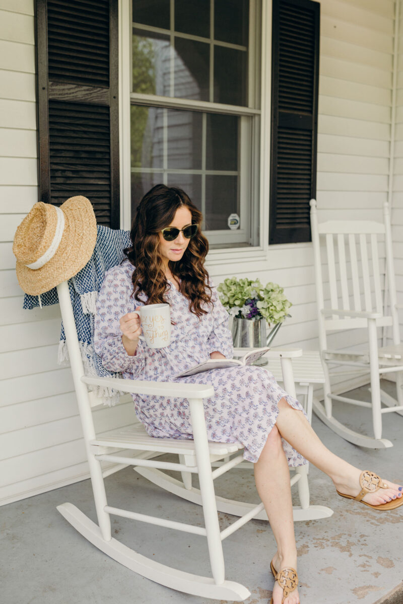 Mom sitting on rocking chair with cup of Coffee