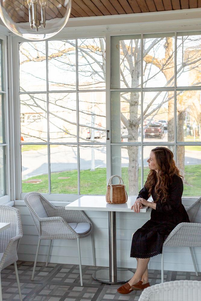 woman sitting in sunroom at 33 Main Lenox Annie Selke
