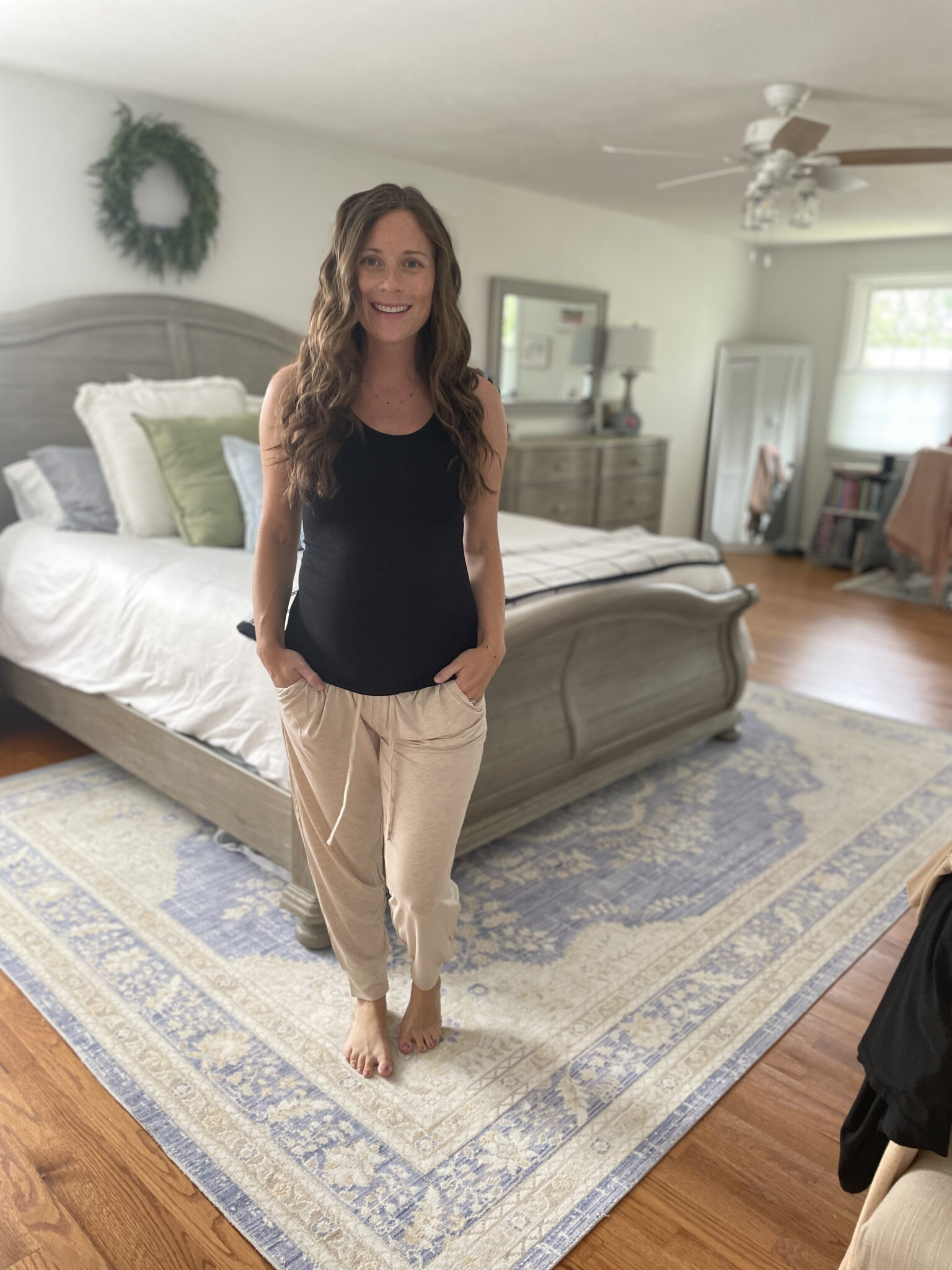 black maternity tank top and tan lounge pants